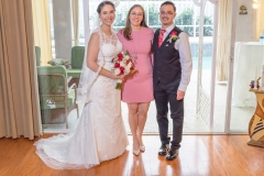 Liana and Franky - and their officiant!